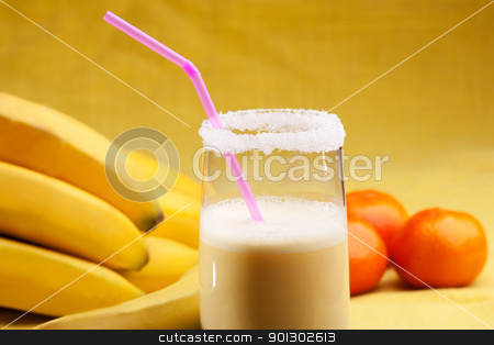 Banana Orange Smoothie stock photo, A smoothie made from oranges and bananas in an elegant glass by Tyler Olson