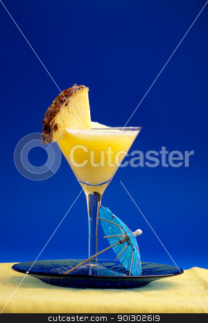 Pina Colada stock photo, A refreshing summer drunk - pina colada over a blue background by Tyler Olson
