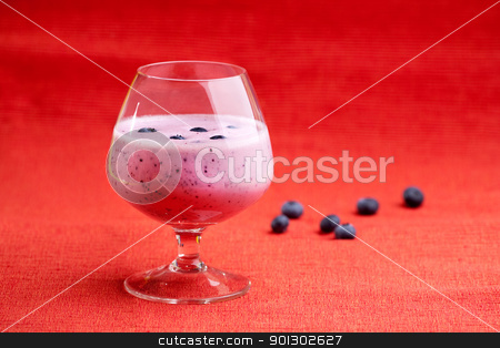 Blueberry Drink stock photo, A delicious blueberry smoothie on a red background by Tyler Olson