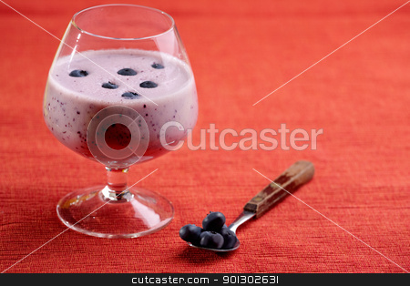 Blueberry Drink stock photo, A delicious blueberry smoothie over a red cloth background by Tyler Olson