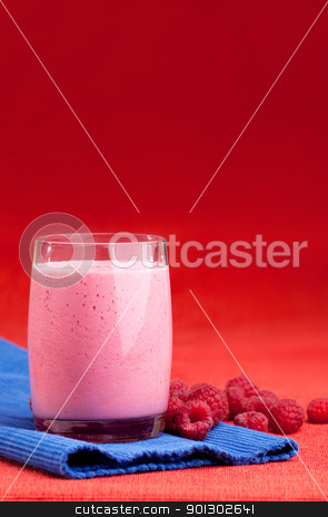 Raspberry Smoothie stock photo, A raspberry smoothie on a red and blue background by Tyler Olson