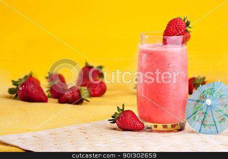 Strawberry Summer Drink stock photo, A fresh summer strawberry drink isolated on yellow by Tyler Olson