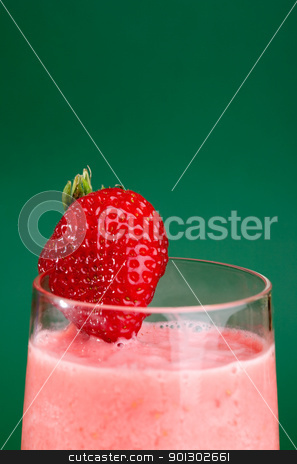 Strawberry Drink stock photo, A fresh summer strawberry drink isolated on green by Tyler Olson