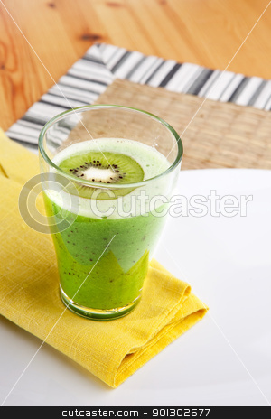 Kiwi Smoothie stock photo, A tasty kiwi smoothie in a natural setting by Tyler Olson