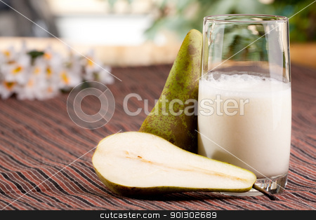 Pear Drink stock photo, A tall glass of pear smoothie in a natural setting by Tyler Olson