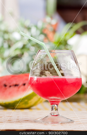 Watermelon Punch stock photo, A glass of watermelon punch outdoors on a table by Tyler Olson