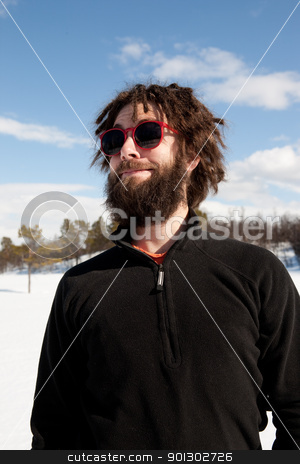Strange Male Portrait stock photo, A funny portrait of a male with a full beard and sunglasses by Tyler Olson
