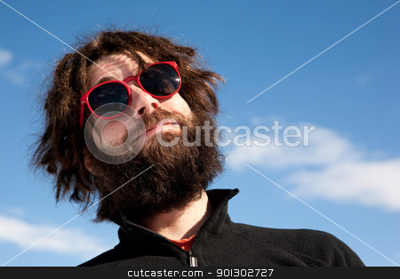 Funny Male Portrait stock photo, A funny portrait of a male with a full beard and sunglasses by Tyler Olson