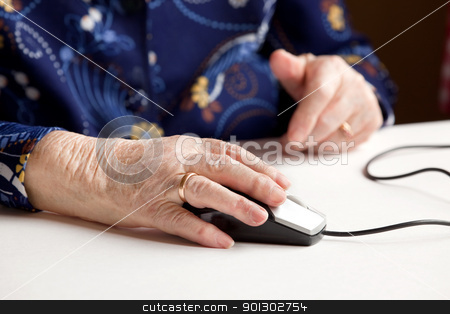 Elderly with Computer stock photo, An elderly hand on a computer mouse by Tyler Olson