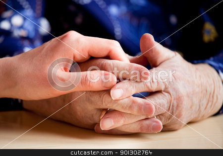 Elderly Care stock photo, A young hand holding an elderly pair of hands by Tyler Olson