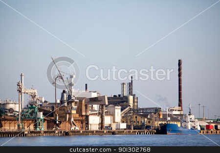 Industrial Shipping Dock stock photo, An industrial shipping dock on the sea by Tyler Olson