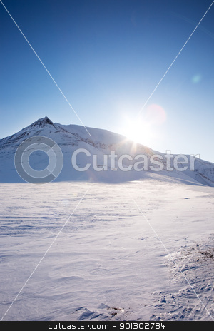 Snow Mountain stock photo, A winter landscape with a mountain and blue sky by Tyler Olson