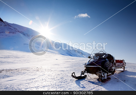 Snowmobile stock photo, A snowmobile in a winter mountain landscape by Tyler Olson