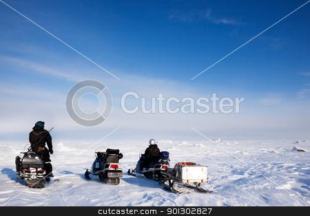 Svalbard Adventure stock photo, Three snowmobiles on a svalbard landscape of barren snow by Tyler Olson
