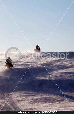 Svalbard Adventure stock photo, Two snowmobiles driving up a hill in a snow storm by Tyler Olson