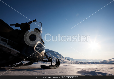 Arctic Landscape stock photo, A snowmobile detail on a barren winter landscape by Tyler Olson