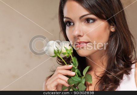 Young woman holding roses stock photo, Close-up of thoughtful pretty young woman holding white roses by Tyler Olson