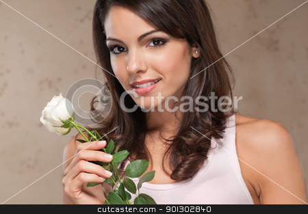 Portrait of woman holding roses stock photo, Close-up portrait of beautiful woman holding flowers and smiling by Tyler Olson