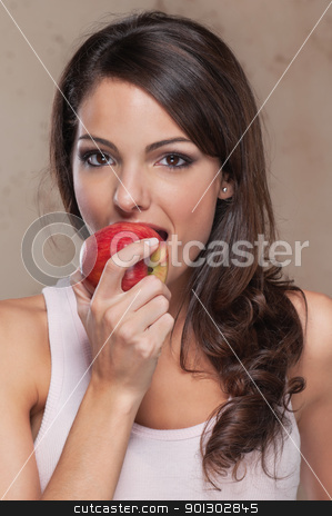 Beautiful young woman eating an apple stock photo, Portrait of beautiful young woman eating an apple by Tyler Olson