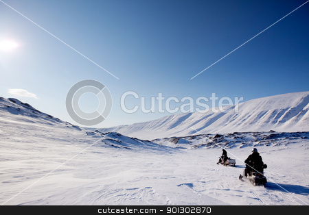 Northern Winter Landsacpe stock photo, Two snowmobiles on a barren winter landscape, Svalbard Norway by Tyler Olson