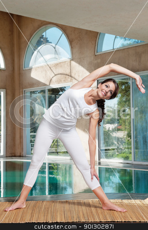 Woman doing stretching exercise stock photo, Beautiful fitness woman doing stretching exercise by Tyler Olson