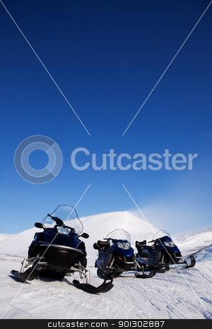 Snowmobile stock photo, Three snowmobiles on an outdoor winter landscape by Tyler Olson