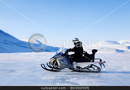 Snomobile stock photo, A snowmobile on a beautiful winter mountain landscape by Tyler Olson