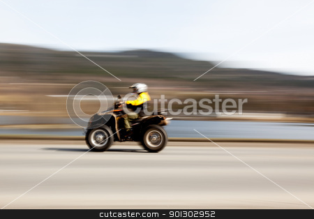 Quad stock photo, A quad on a road with motion blur by Tyler Olson