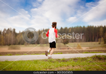 Retro Runner stock photo, A runner with long hair and beard jogging in the country by Tyler Olson