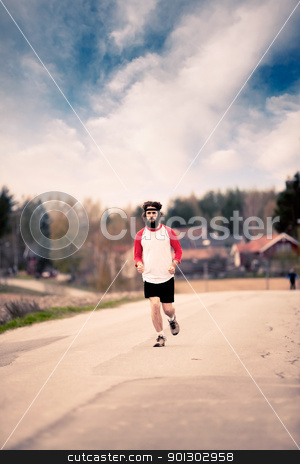 Retro Runner stock photo, A runner with long hair and beard jogging in the country - Retro style image by Tyler Olson