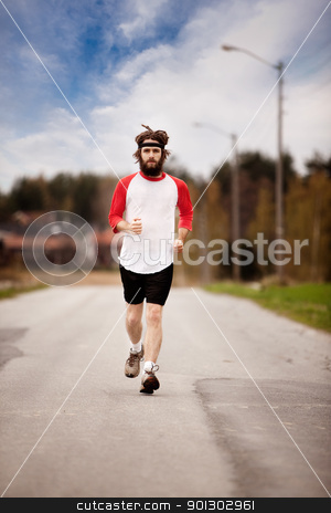 Cross Country Jog stock photo, A tired retro style jogger running on a road outdoors by Tyler Olson