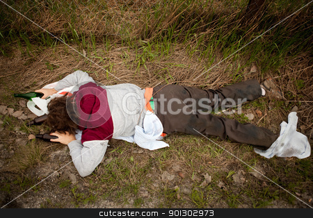 Homeless Man stock photo, A drunk homeless man laying the ditch by Tyler Olson