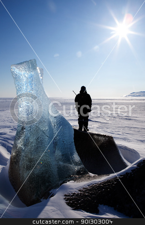 Frozen Glacier Landscape stock photo, An adventure guide looks onto the horizon on the east coast of Spitsbergen, Svalbard, Norway by Tyler Olson
