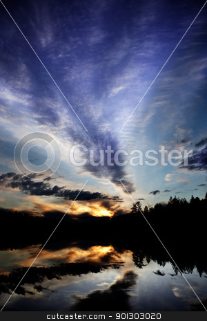 Lake Reflection stock photo, A dramatic sunset over a lake in a forest - Norway by Tyler Olson