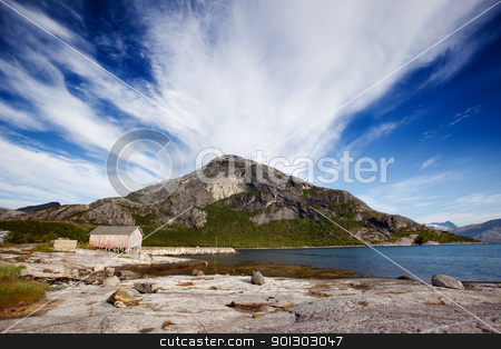 Mountain Norway Coast stock photo, A mountain on the coast of Norway near a small fishing village by Tyler Olson
