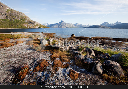 Coast Norway  stock photo, The coast in northern Norway with mountains, ocean and rock by Tyler Olson