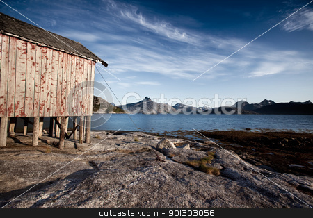 Norway Coast Boat House stock photo, A boat house on the coast of northern Norway by Tyler Olson