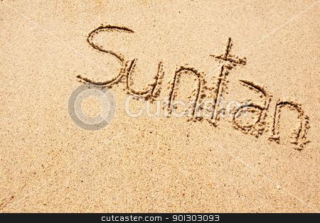 Suntan stock photo, The word suntan written in the sand on a beach by Tyler Olson