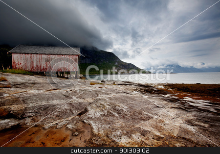 Fishing Village stock photo, A detail on the coast of a small fishing village in northern Norway by Tyler Olson