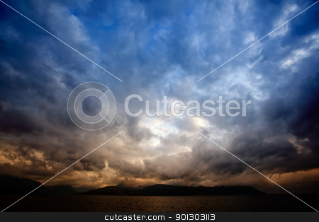 Storm Clouds stock photo, A brewing storm on an ocean sunset by Tyler Olson