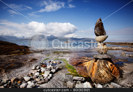 Rock Stacking Sculpture stock photo, A rock stacking sculpture statue on a Norwegian landscape by Tyler Olson