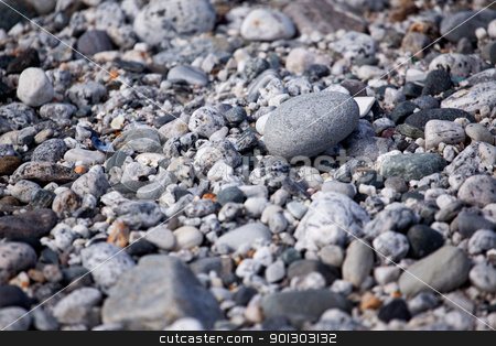Pebble Background stock photo, A smooth pebble surface texture background by Tyler Olson