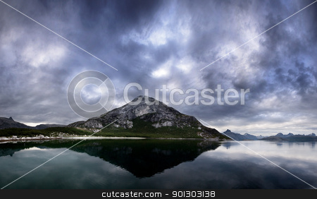 Norway Landscape stock photo, A landscape of a dramatic sky and mountain on the northern coast of Norway by Tyler Olson