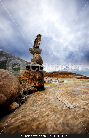 Rock Stack Sculpture stock photo, A rock stacking sculpture statue on a Norwegian landscape by Tyler Olson