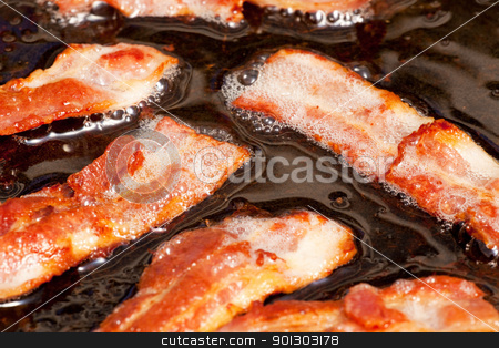 Frying Bacon stock photo, A bacon cooking detail, slices of bacon in fat by Tyler Olson