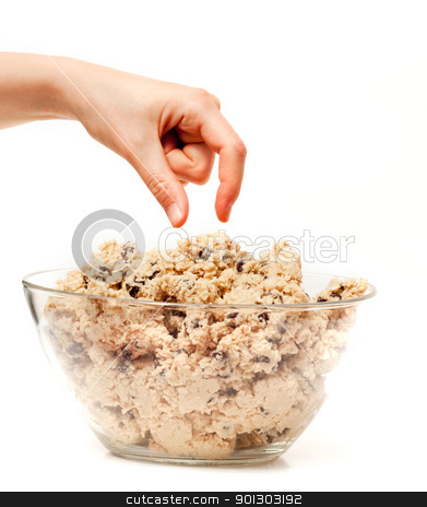 Cookie Dough Taste Test stock photo, A hand reaching for a bowl of raw cookie dough by Tyler Olson