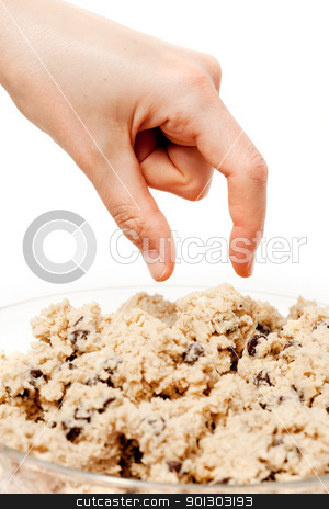 Cookie Dough Eat stock photo, A hand reaching for a bowl of raw cookie dough by Tyler Olson