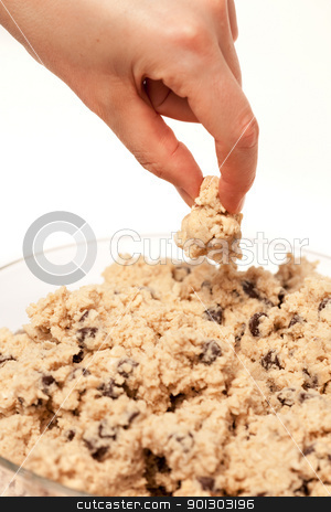 Cookie Dough stock photo, A hand grabbing a test taste of cookie dough by Tyler Olson