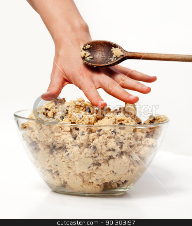 Cookie Dough Snack stock photo, A hand reaching for cookie dough and getting caught by Tyler Olson