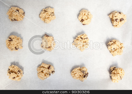 Cookie Dough on Pan stock photo, Cookie dough on a cookie sheet with baking paper by Tyler Olson